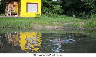 man swim pond dirty water - Man head in dirty little garden...