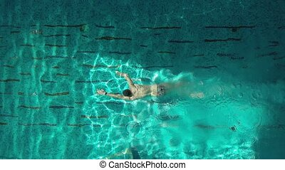 Man swimmer in the pool- aerial view