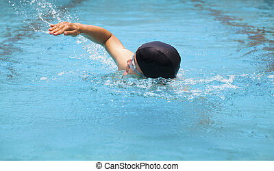 man swimmer swimming in the pool