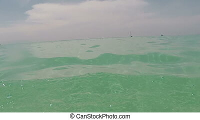 Man Swimming In Sea With Action Camera Water Point Of View...