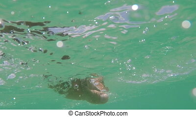 Man Swimming In Sea With Action Camera Underwater Point Of...