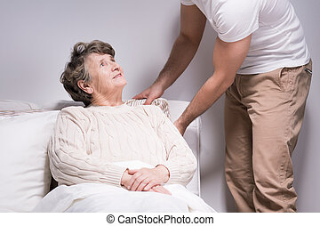 Man take care of grandmother