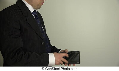 man take euro money from leather wallet and put in suit...