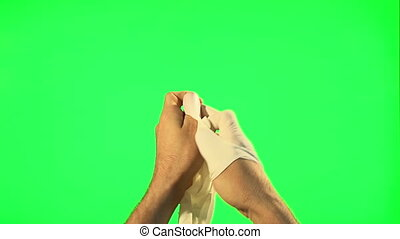 Man take off surgical gloves - Man take off and puts on his...