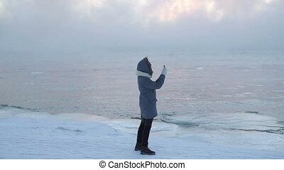 man take photo on the ice