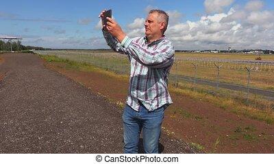 Man take selfies on smartphone