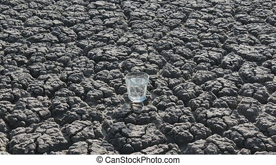 Man take up glass with water from ground