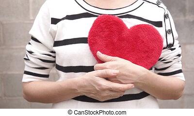 Man Takes Heart of Woman