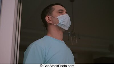 Man takes off medical mask and takes deep breath - ...