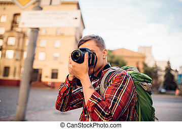 Man takes picture of tourist attractions on camera - Man...