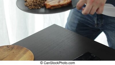 Man takes plate of food and leaves - Anonymous person picks...