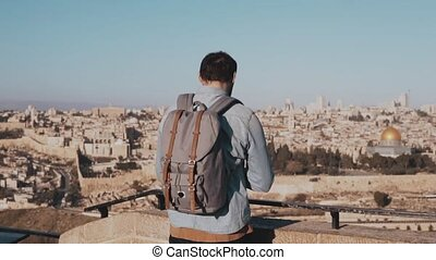 Man takes smartphone photos in Israel, Jerusalem. European...