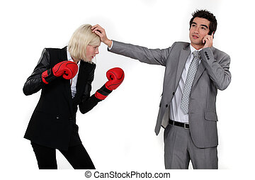Man taking a break from fighting with his colleague to answer the phone