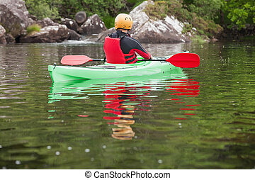 Man taking a break in his kayak
