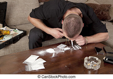man taking a line cocaine - cocaine drug dealer taking a...