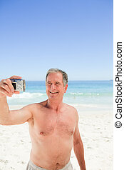 Man taking a photo of himself