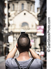 man taking a photo of the Pilar in Zaragoza, Spain