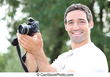 Man taking a photo with a DSLR camera