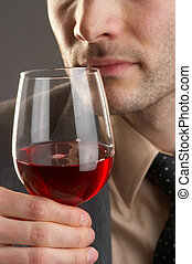 wine - Man taking a smell at a glass of red wine