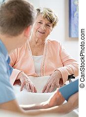 Man taking care of older woman