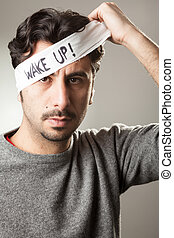 "Wake Up! - Man Taking Off a Bandage from His Eyes with ""Wake..."