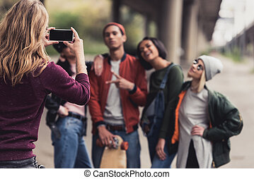 man taking photo of friends