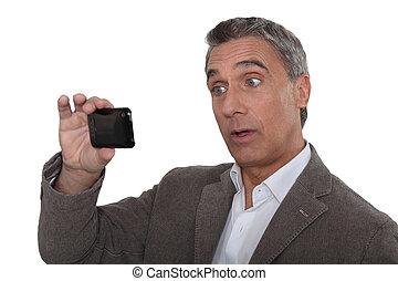Man taking photo on mobile telephone