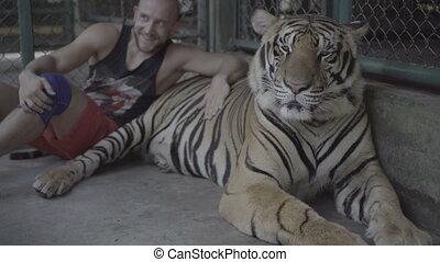 Man taking photo with big tiger. - Tourist man smiling,...
