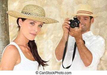 Man taking photograph of girlfriend