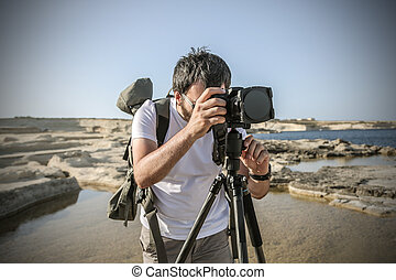Man taking photos in the nature