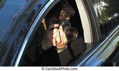 Man taking picture from the car - Private detective sitting ...