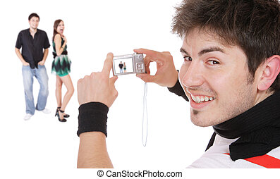 Man taking pictures in studio camera in hands isolated on ...