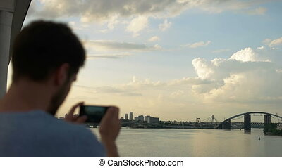 Man taking pictures of amazing landscape on mobile smart phone digital camera ,beautiful sunset light create background with copy space for text message