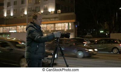 Man taking pictures of the night landscape