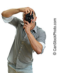Man taking pictures with retro camera. Isolated on white.