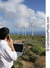 Man taking reading from wind farm