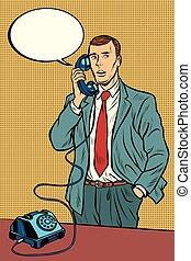 man talking on a retro phone