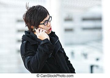 man talking on mobile hone