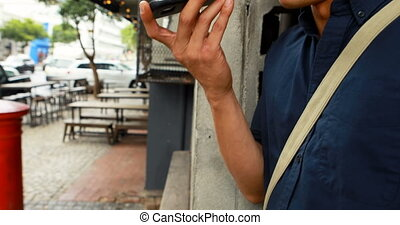 Man talking on mobile phone at outdoor cafe 4k - Close-of of...