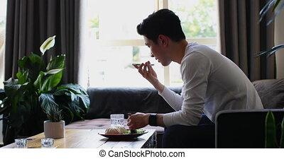 Man talking on mobile phone in living room 4k