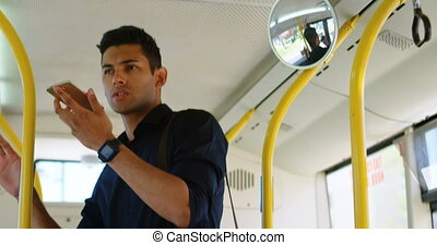 Man talking on mobile phone in the bus 4k - Handsome man...