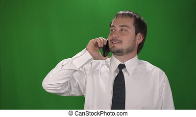 man talking on mobile phone over a green screen background