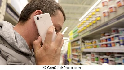 Man talking on phone in store