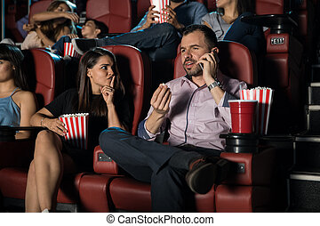 Man talking on the phone at the movies - Annoying man ...