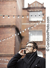 Man talking over the phone in industrial area
