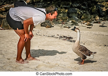Man talking to a geese