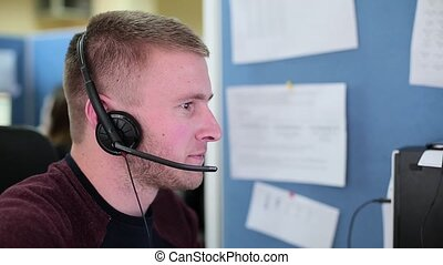 Man talking with a client in a call center