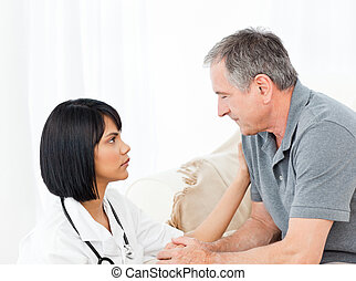 Man talking with his nurse