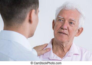 Man talking with senior father