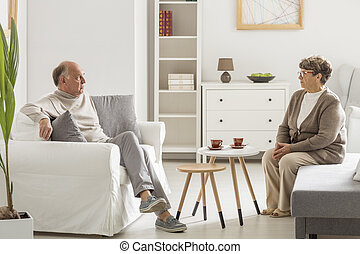 Man talking with woman